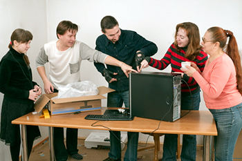 Family unwrapping a new computer