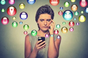 Woman Looking at Social Media Icons